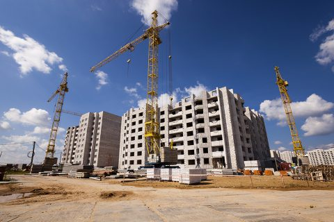 a construction site on which construction of a new multystoried house is carried out.