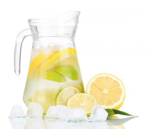 21288650 - cold water with lime, lemon and ice in pitcher isolated on white
